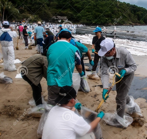 beach-clean-up-rayong-thailand-jul-people-clearing-contaminated-sand-aou-prow-jul-spilled-oil-came-32707287